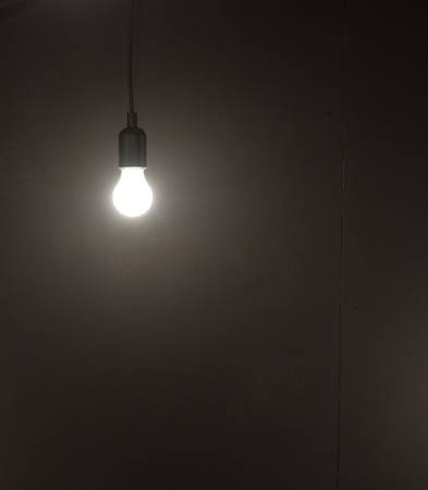 50388362-single-light-bulb-hanging-with-plain-simple-background